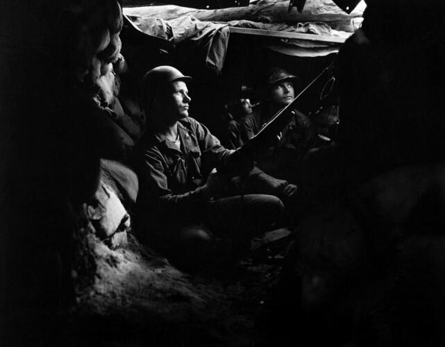 Infantrymen of the 27th Infantry Regiment, near Heartbreak Ridge, take advantage of cover and concealment in tunnel positions, 40 yards from the Communists Image